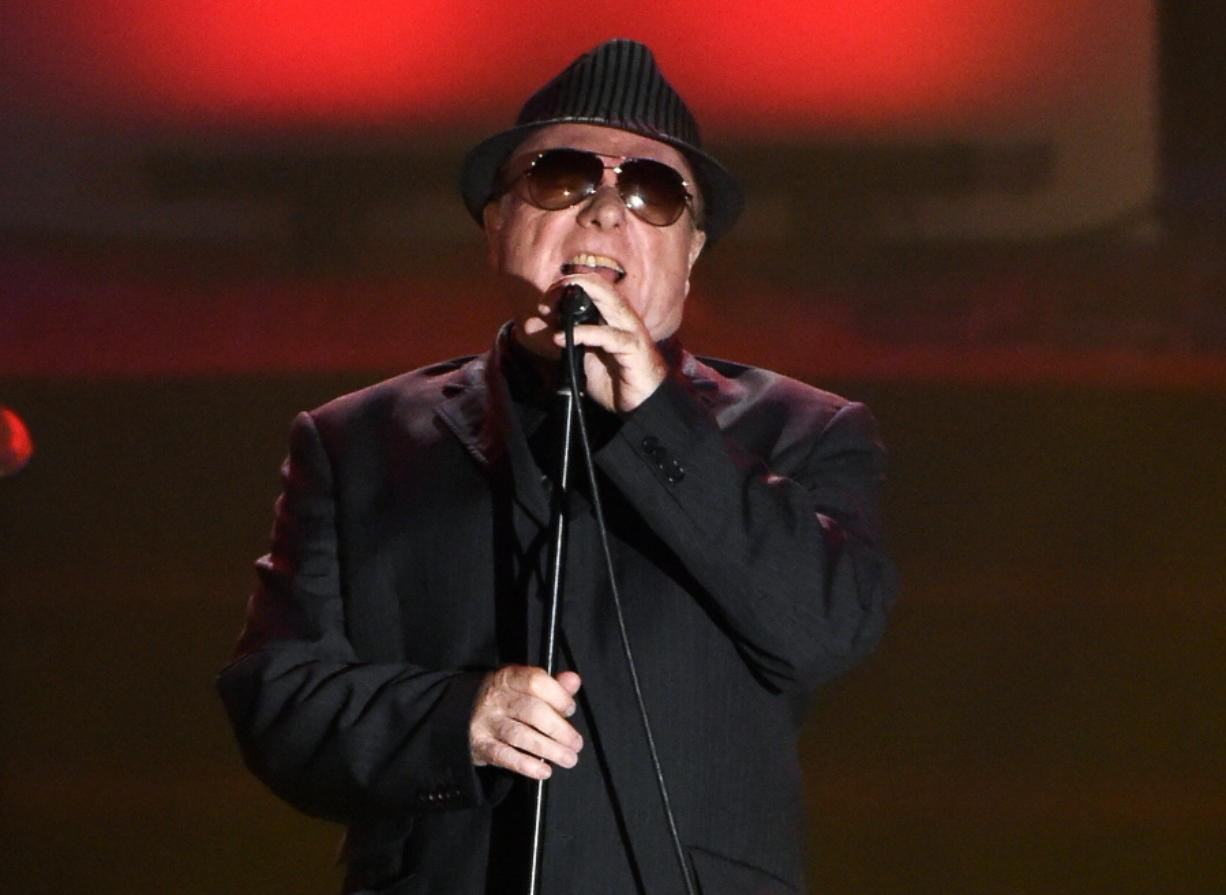 FILE - In this June 18, 2015 file photo, Van Morrison performs at the 46th annual Songwriters Hall of Fame Induction and Awards Gala in New York. Van Morrison is to release three new songs over the coming weeks that take a swipe at the lockdown restrictions imposed by the British government.