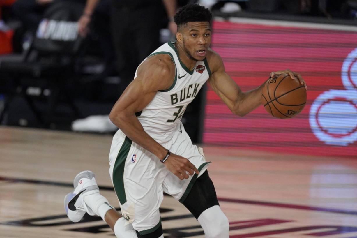 Milwaukee Bucks' Giannis Antetokounmpo (34) in the second half of an NBA conference semifinal playoff basketball game against the Miami Heat Friday, Sept. 4, 2020, in Lake Buena Vista, Fla. (AP Photo/Mark J.
