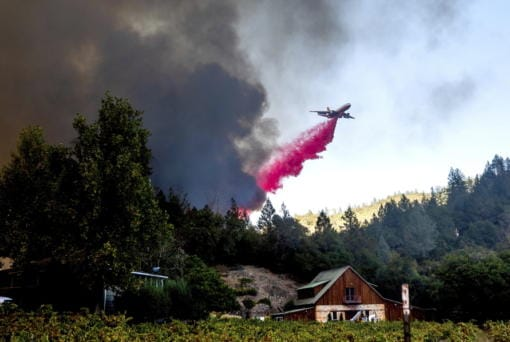 An air tanker drops retardant while battling the Glass Fire in St. Helena, Calif., on Sunday, Sept. 27, 2020.