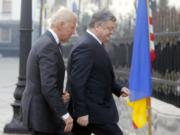 "FILE - In this Jan. 16, 2017, file photo Vice President Joe Biden, left, and Ukrainian President Petro Poroshenko go for talks during Biden's visit in Kiev, Ukraine. The leaked recordings of apparent conversations between Joe Biden and Ukraine's then-president largely confirm Biden's account of his dealings in Ukraine. The choppy audio, disclosed by a Ukrainian lawmaker whom U.S. officials described Thursday, Sept. 10, 2020, as an ""active Russian agent"" who has sought to spread online misinformation about Biden."