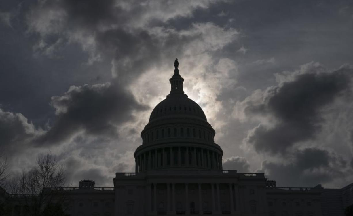 FILE - In this April 12, 2019, file photo, morning clouds cover Capitol Hill in Washington, as Congress leaves for a two week recess. Philanthropy is stepping in to fund U.S. elections during the coronavirus pandemic. This comes after Congress has failed to approve additional funding to help election officials adjust to an expected avalanche of mail ballots and need to sanitize polling places. (AP Photo/J.