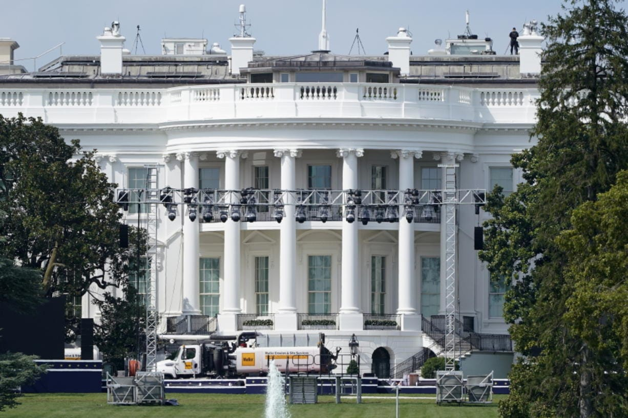 FILE - In this Aug. 21, 2020, file photo lights and staging stand on the South Lawn of the White House, Friday, Aug. 21, 2020, in Washington. President Donald Trump is expected to speak to the Republican National Committee convention next week from the South Lawn of the White House.