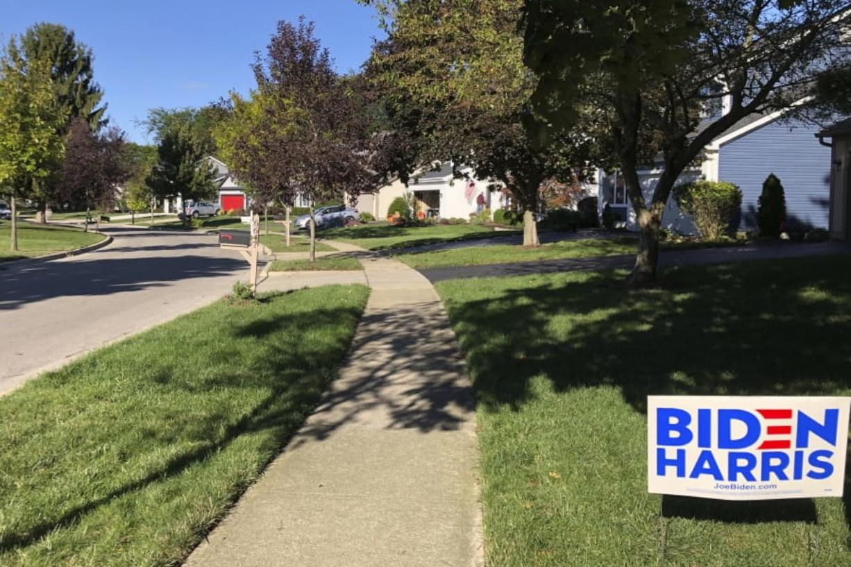 A Biden for President sign in a lawn of suburban Dublin, Ohio, on Friday, Sept. 18, 2020. In the campaign for House control, some districts are seeing a fight between Democrats saying they'll protect voters from Republicans willing to take their health coverage away, while GOP candidates are raising specters of rioters imperiling neighborhoods if Democrats win.