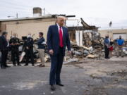 """FILE - In this Sept. 1, 2020 file photo, President Donald Trump tours an area damaged during demonstrations after a police officer shot Jacob Blake in Kenosha, Wis. Wisconsin Democrats, stung by President Trump's narrow win four years ago, are confident the lessons they learned will ensure he doesn't do it again. But Republicans say civil unrest that followed a police shooting in Kenosha, and Trump's """"law and order"""" message, will help him win over the crucial white suburban voters he needs to capture a second term."""