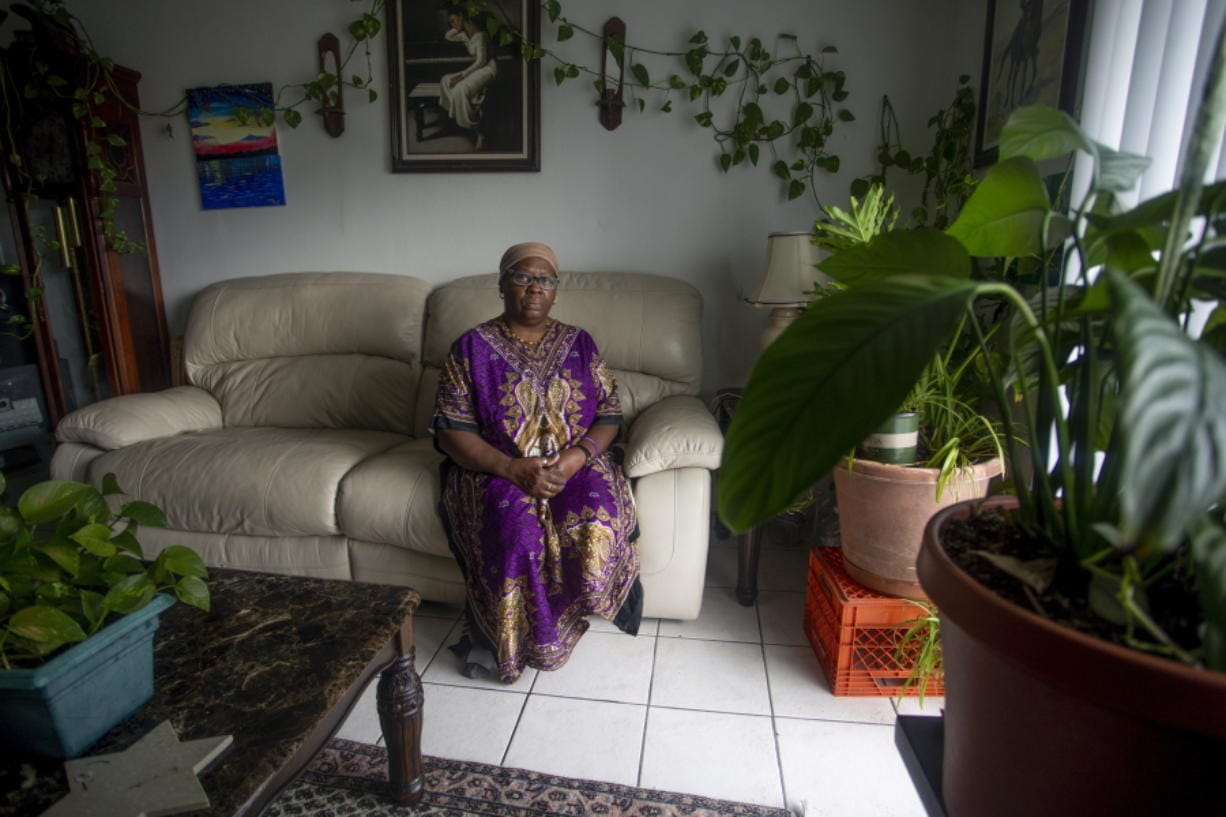 Yochebed Israel, a certified nursing assistant, poses for a portrait inside her Tampa, Fla. apartment on Monday, Aug. 17, 2020. Israel's landlord tried to evict her in violation of the CARES Act after she fell behind on rent after contracting COVID-19.