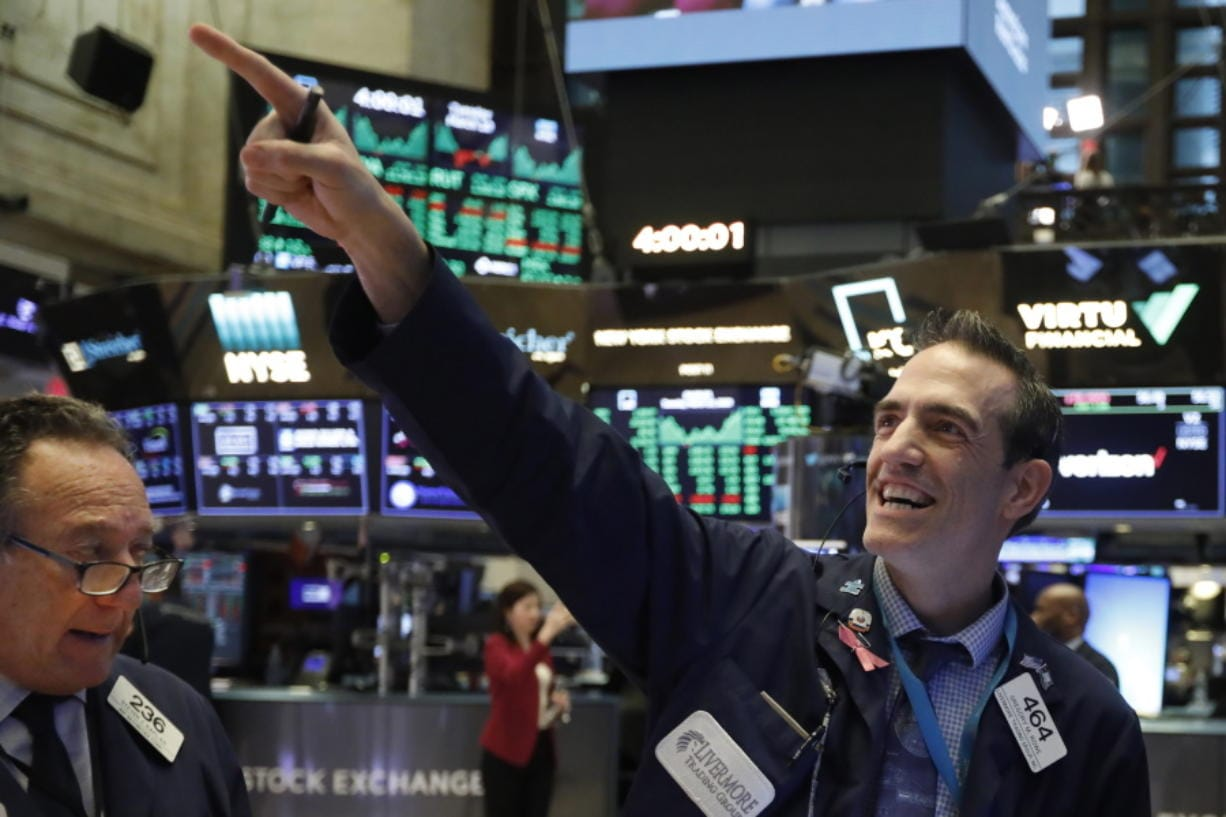 FILE - In this March 10, 2020, file photo, traders Steven Kaplan, left, and Gregory Rowe react at the closing on the floor of the New York Stock Exchange. Wall Street is opening slightly higher, Tuesday, Sept. 22, 2020, as markets recover from steep losses Monday.