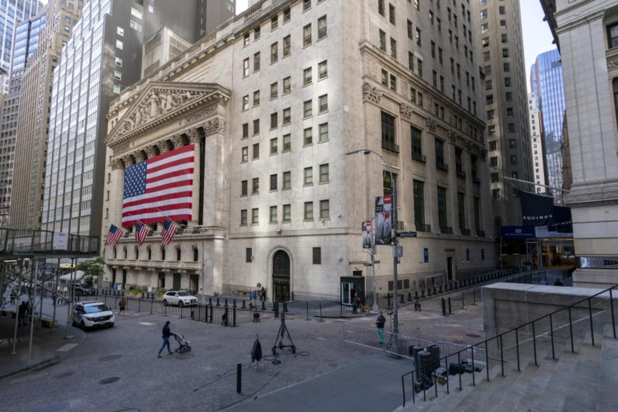 A giant American Flag hangs on the New York Stock Exchange, Monday, Sept. 21, 2020.  U.S. stock indexes are mixed in early trading Wednesday, as Wall Street's tumultuous month continues to churn.