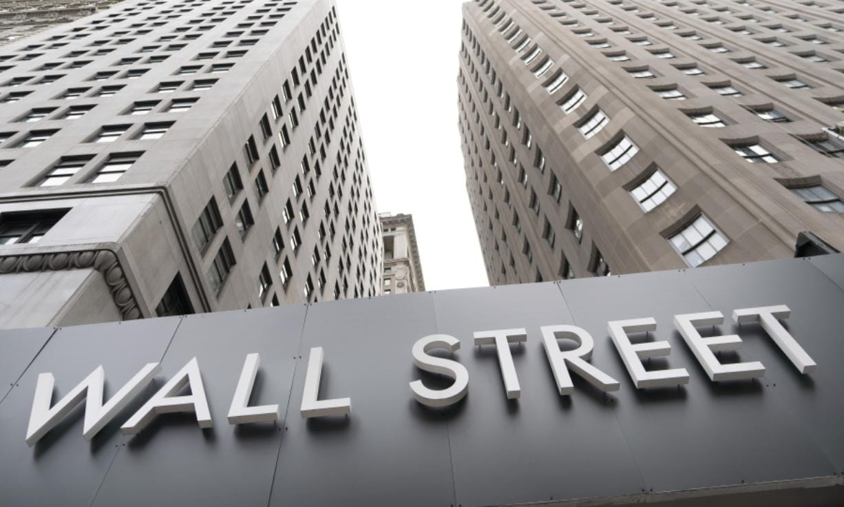 FILE - In this Aug. 31, 2020 file photo, buildings line Wall Street, in New York. Stocks are opening higher on Wall Street Thursday, Sept. 10 as the market claws back some more of the ground it lost in a three-day slump that snapped a day earlier.