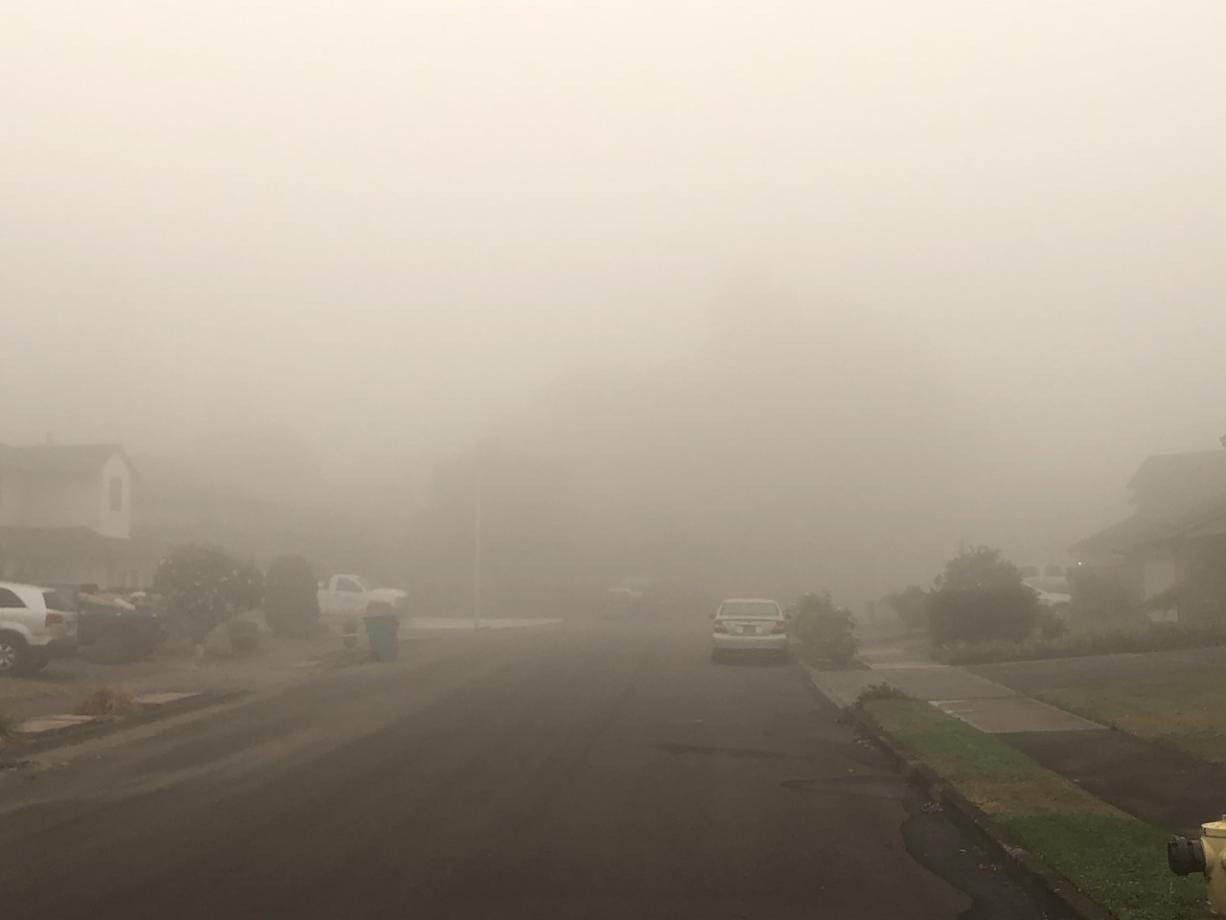 Dense fog and wildfire smoke clouded the air in Clark County on Sunday morning, leading to multiple alerts from the National Weather Service.
