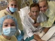 "This handout photo published by Russian opposition leader Alexei Navalny on his instagram account, shows himself, centre, and his wife Yulia, right, daughter Daria, and son Zakhar, top left, posing for a photo in a hospital in Berlin, Germany.  Russian opposition leader Alexei Navalny has posted the picture of himself in a hospital in Germany and says he's breathing on his own. He posted on Instagram Tuesday Sept. 15, 2020: ""Hi, this is Navalny. I have been missing you."
