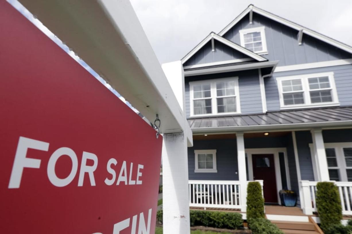 """FILE - In this April 1, 2020 photo, a """"For Sale"""" sign stands in front of a home that is in the process of being sold in Monroe, Wash., outside of Seattle. Sales of new homes rose by a very strong 4.8% in August to a seasonally-adjusted annual rate of 1.01 million units. The gains reported Thursday, Sept. 24 by the The Commerce Department follow steep declines in March and April when COVID-19 infections spread in the U.S."""