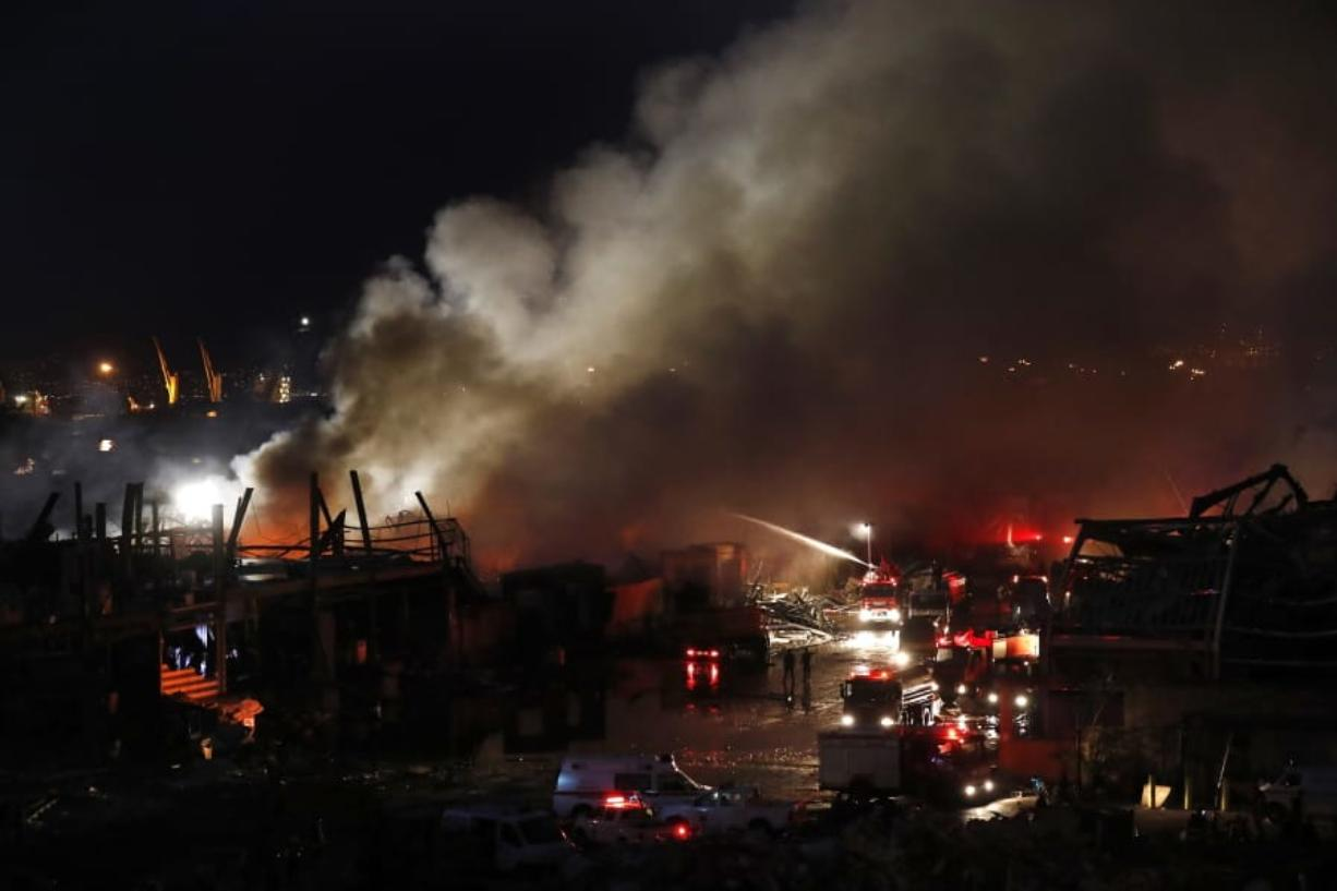 Firefighters extinguish a fire in warehouses at the seaport of Beirut, Lebanon, Thursday, Sept. 10. 2020. A huge fire broke out Thursday at the Port of Beirut, triggering panic among residents traumatized by last month's massive explosion that killed and injured thousands of people.