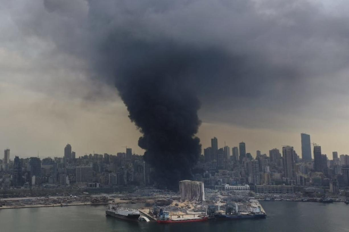 Black smoke rises from a fire at warehouses at the seaport of Beirut, Lebanon, Thursday, Sept. 10. 2020. A huge fire broke out Thursday at the Port of Beirut, triggering panic among residents traumatized by last month's massive explosion that killed and injured thousands of people.