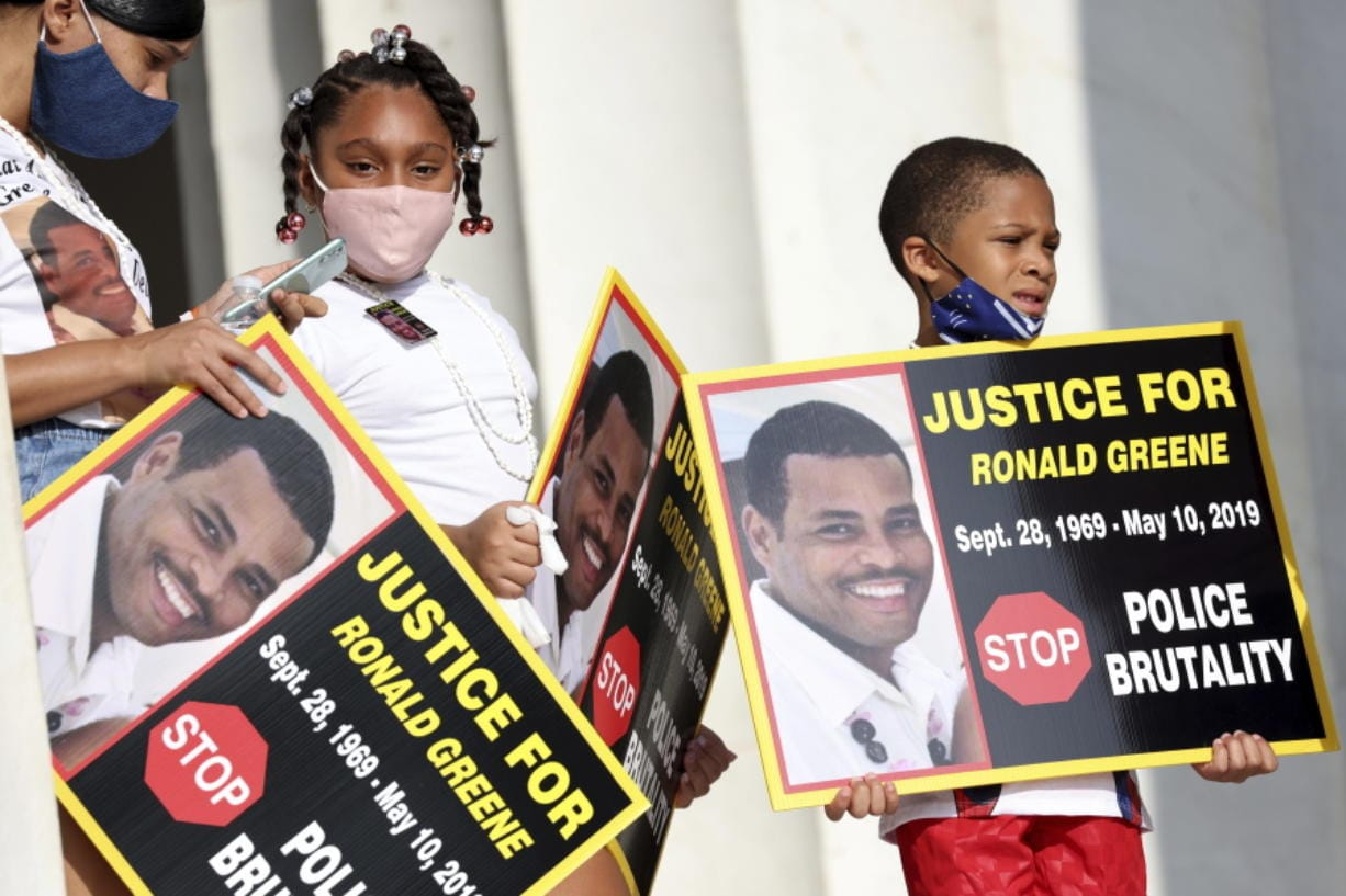 """FILE - In this Aug. 28, 2020 file photo, family members of Ronald Greene listen to speakers as demonstrators gather for the March on Washington, in Washington, on the 57th anniversary of the Rev. Martin Luther King Jr.'s """"I Have A Dream"""" speech. Officials told The Associated Press, federal authorities are investigating the death of Greene during what Louisiana State Police described as a struggle to take him into custody following a rural police chase last year. The death of the 49-year-old remains shrouded in secrecy because State Police have declined to release body-camera footage related to the May 2019 chase north of Monroe, La. (Michael M."""