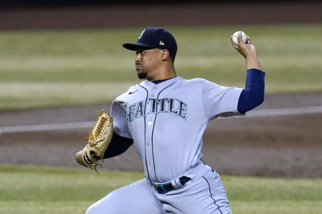 Seattle Mariners starting pitcher Justus Sheffield throws to an Arizona Diamondbacks batter during the first inning of a baseball game Saturday, Sept. 12, 2020, in Phoenix. (AP Photo/Ross D.