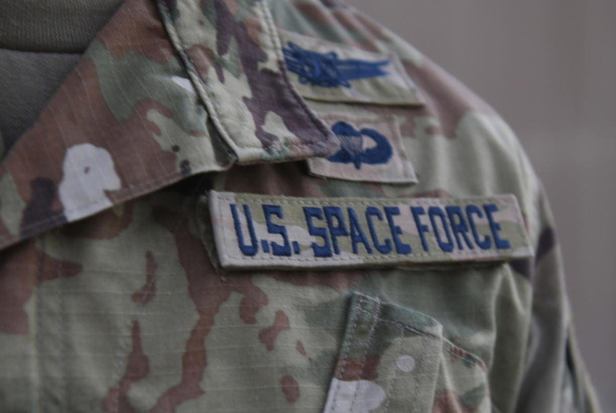 In this photo released by the U.S. Air Force, Capt. Ryan Vickers stands for a photo to display his new service tapes after taking his oath of office to transfer from the U.S. Air Force to the U.S. Space Force at Al-Udeid Air Base, Qatar, Tuesday, Sept. 1, 2020. Space Force, the first new U.S. military service since the creation of the Air Force in 1947, now has some 20 members stationed at Qatar's Al-Udeid Air Base in its first foreign deployment. (Staff Sgt. Kayla White/U.S.
