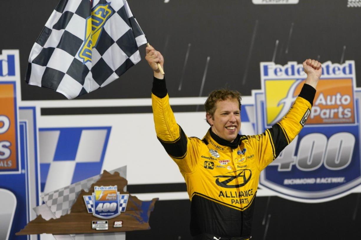 Brad Keselowski (2) celebrates in Victory Lane after winning a NASCAR Cup Series auto race Saturday, Sept. 12, 2020, in Richmond, Va.