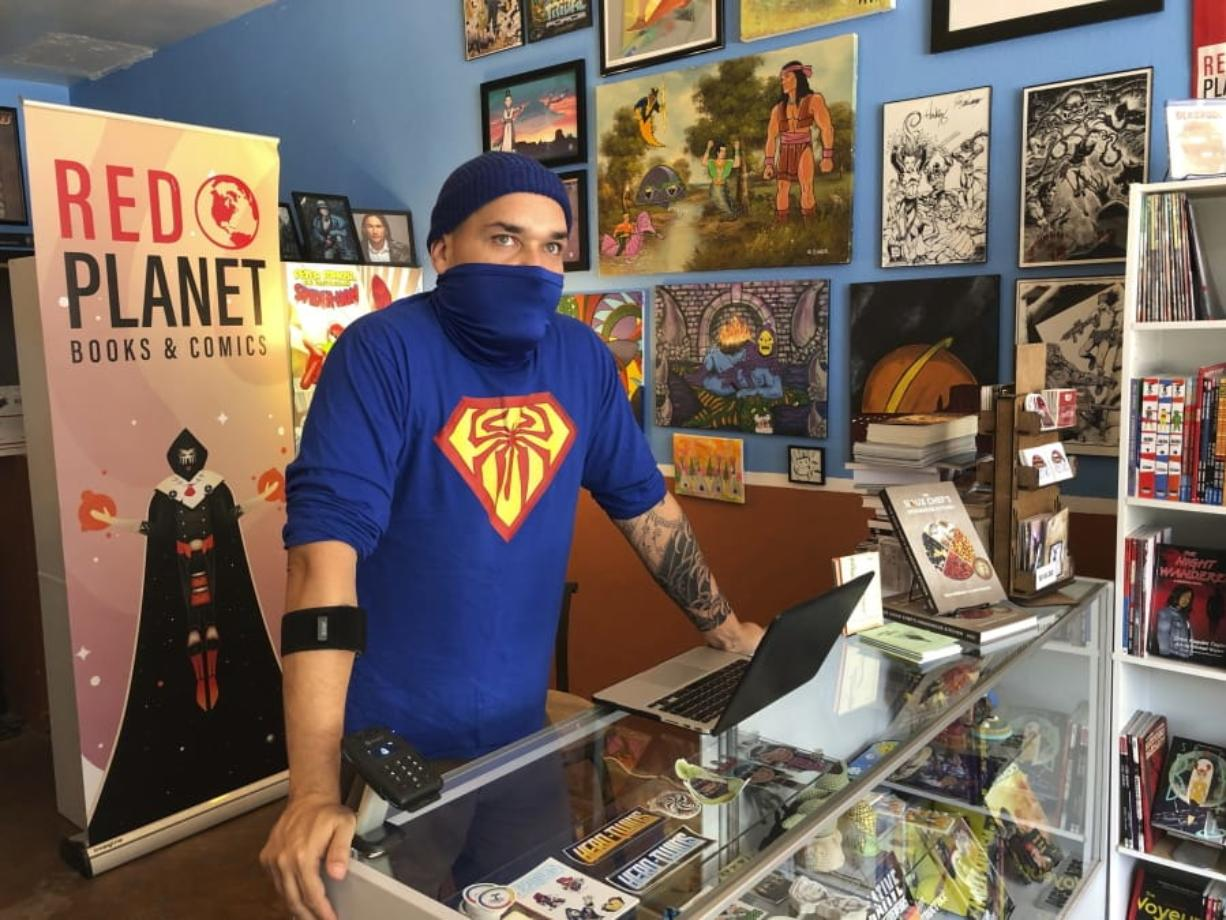 """Aaron Cuffee of Red Planet Books & Comics in Albuquerque, N.M., discusses the potential that could come from Marvel Comics' effort to assemble a gallery of Native artists and scribes for """"Marvel Voices: Indigenous Voices #1."""" (Susan Montoya Bryan/Associated Press)"""