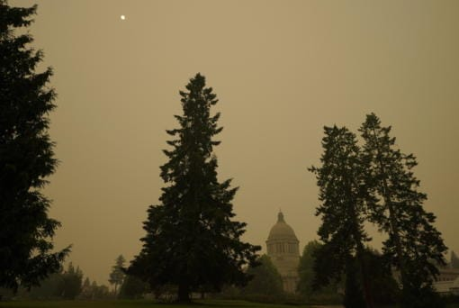 Smoke from wildfires in Oregon and California creates hazy skies as the sun is seen above the Washington state Capitol, Saturday afternoon, Sept. 12, 2020, in Olympia, Wash. Numerous air quality warnings were in place for most of the West through the weekend. (AP Photo/Ted S.