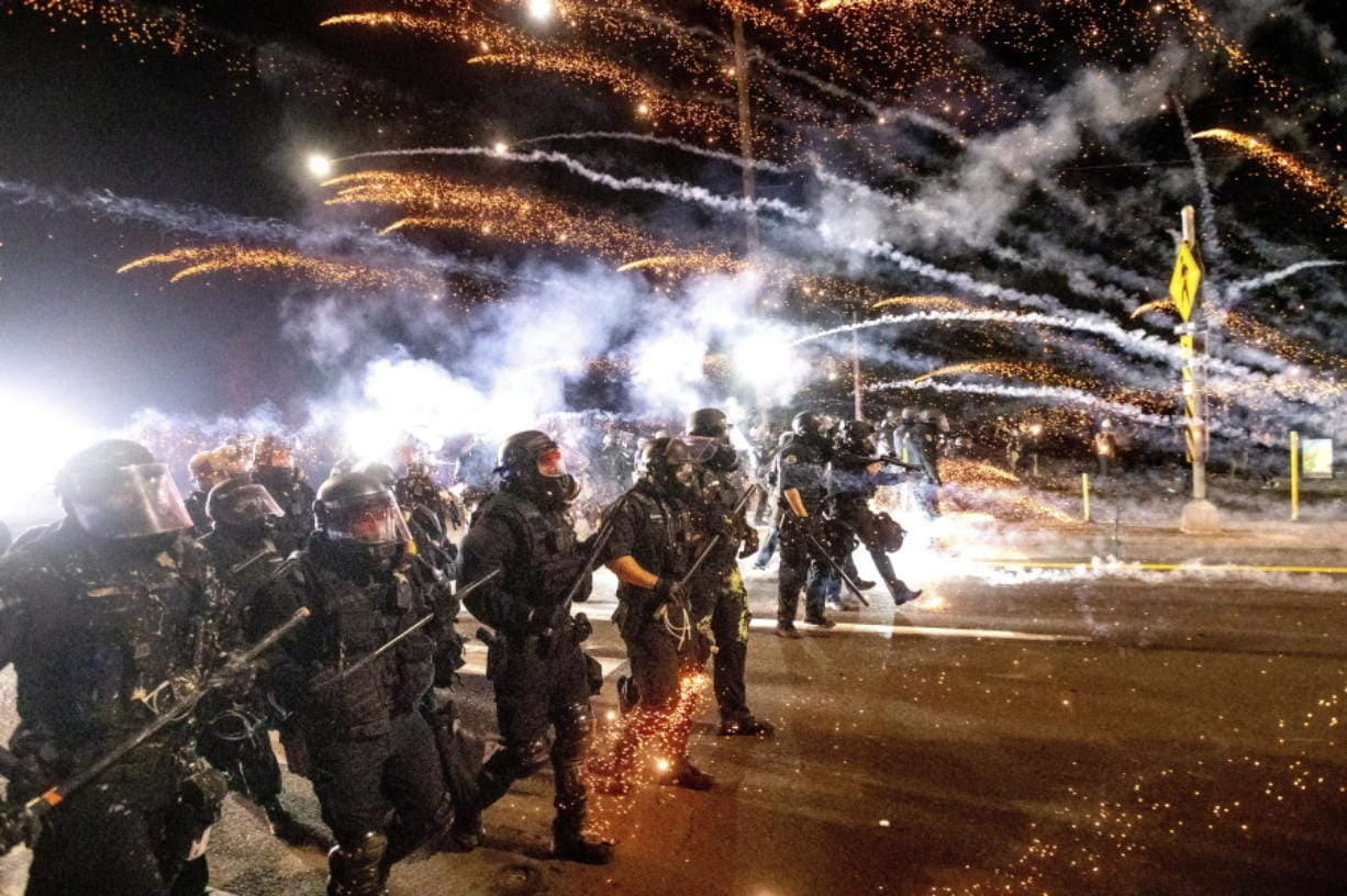Police use chemical irritants and crowd control munitions to disperse protesters Sept. 5 in Portland.
