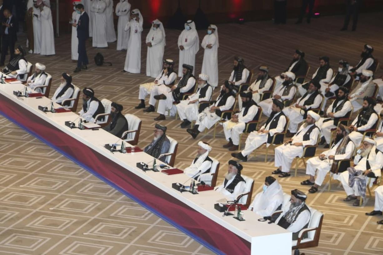 Taliban negotiator Abbas Stanikzai, fifth right, with his delegation attend the opening session of the peace talks between the Afghan government and the Taliban in Doha, Qatar, Saturday, Sept. 12, 2020.
