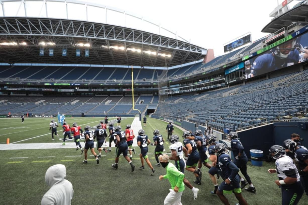 The Seattle Seahawks take to an empty CenturyLink Field for an August scrimmage. It will look a lot like this on Sunday night, Sept. 20, 2020, when the New England Patriots visit Seattle.