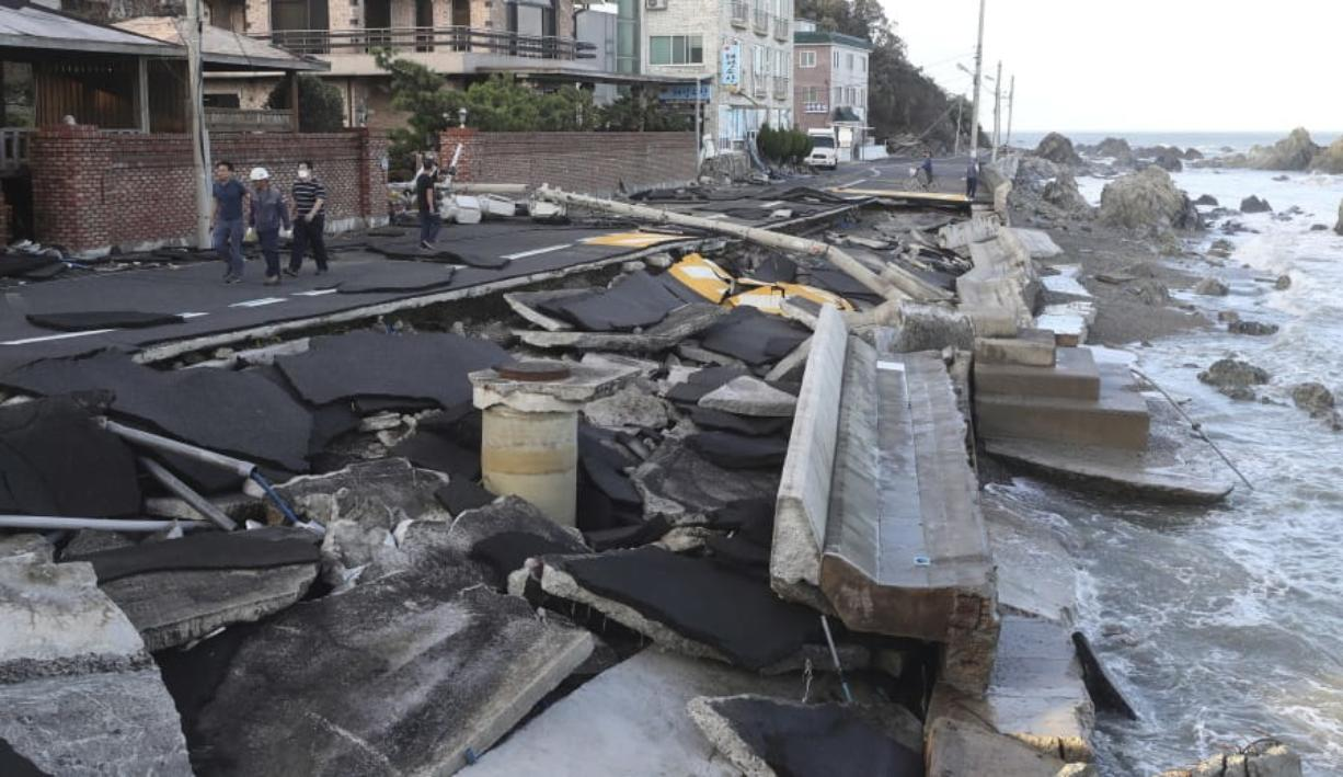 A coastal road is damaged in Ulsan, South Korea, Monday, Sept. 7, 2020. A powerful typhoon damaged buildings, flooded roads and knocked out power to thousands of homes in South Korea on Monday after battering islands in southern Japan and injuring dozens of people.