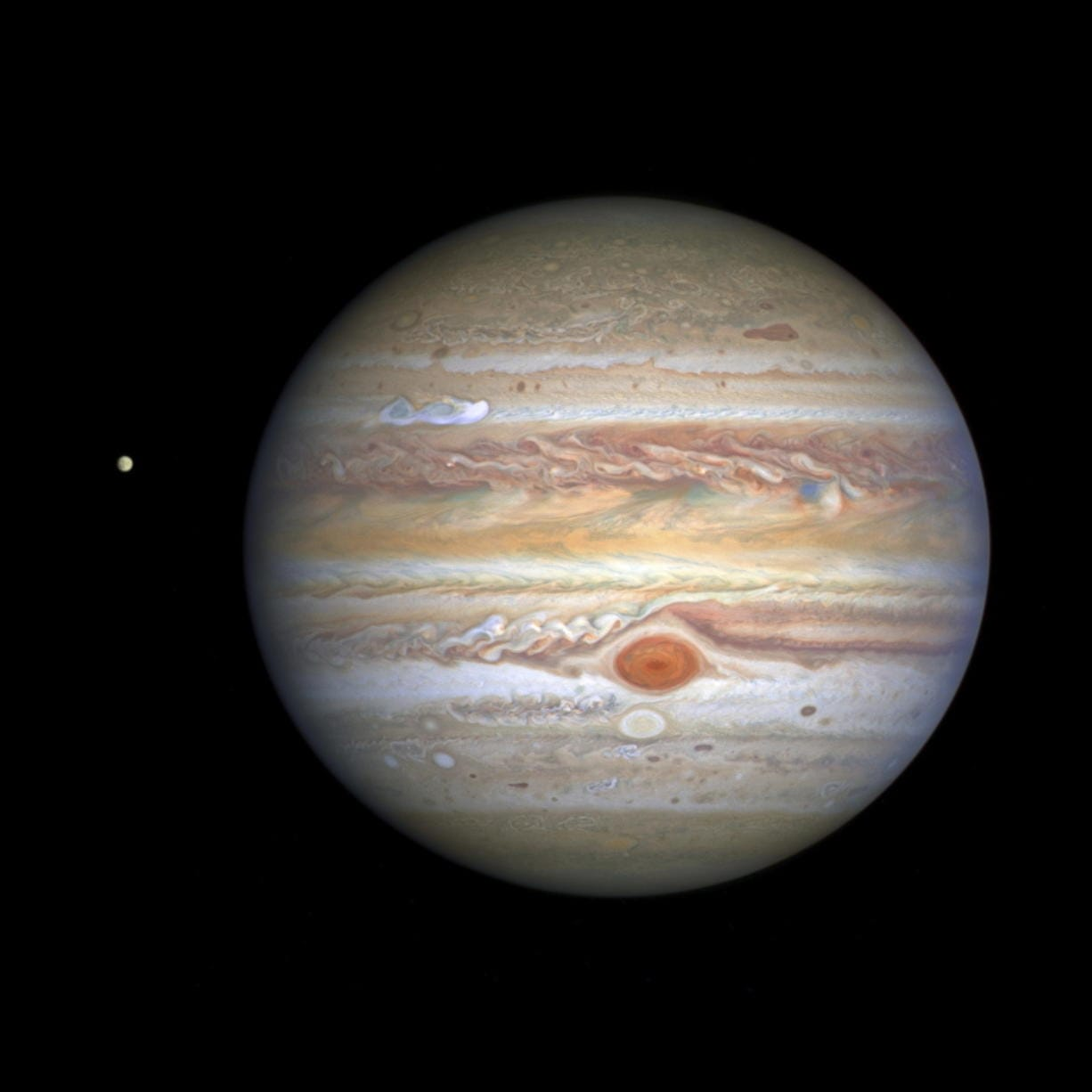 This Aug. 25 image captured by NASA's Hubble Space Telescope shows the planet Jupiter and one of its moons, Europa, at left, when the planet was 406 million miles from Earth. (NASA, ESA, STScI, A.