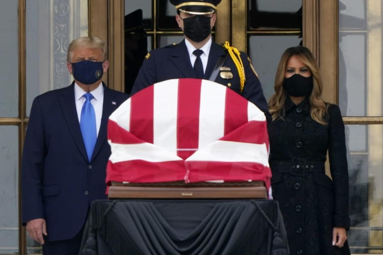 President Donald Trump and first lady Melania Trump pay respects as Justice Ruth Bader Ginsburg lies in repose at the Supreme Court building on Thursday, Sept. 24, 2020, in Washington. Ginsburg, 87, died of cancer on Sept. 18. (AP Photo/J.