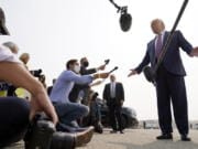 President Donald Trump speaks to reporters as he arrives at Sacramento McClellan Airport, in McClellan Park, Calif., on Monday, for a briefing on wildfires.