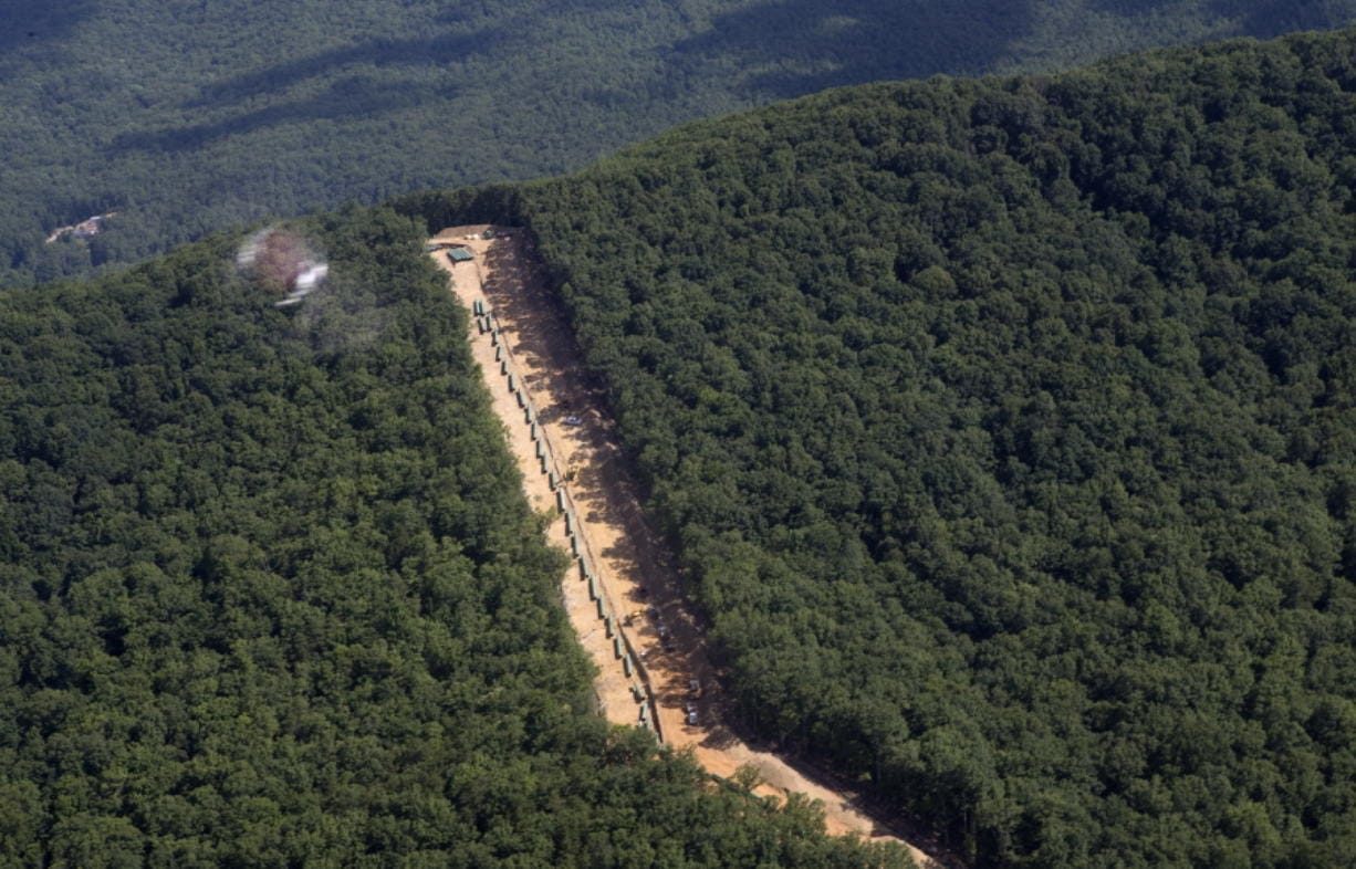 FILE - This July 18, 2018, file photo, shows the Mountain Valley Pipeline route on Brush Mountain in Virginia. The Trump administration is seeking to fast track environmental reviews of the pipeline and dozens of other energy, highway and other infrastructure projects across the U.S.