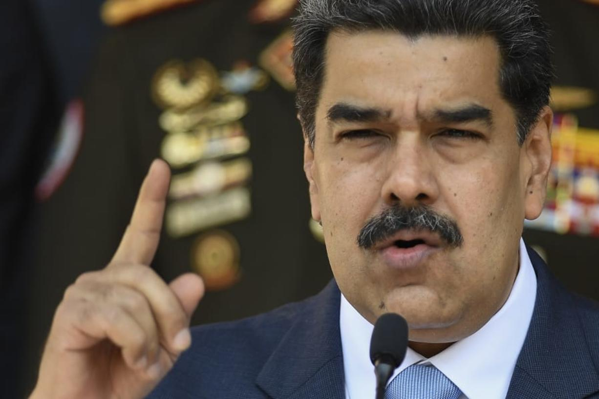 FILE - In this March 12, 2020 file photo, Venezuelan President Nicolas Maduro gives a press conference at Miraflores presidential palace in Caracas, Venezuela. Independent experts commissioned by the U.N.'s top human rights body have issued a scathing, in-depth report finding the government of Venezuelan President Nicolas Maduro responsible for crimes against humanity. The report commissioned last year by the 47-member-state Human Rights Council said the alleged crimes include extrajudicial executions, enforced disappearances, arbitrary detentions and torture. The findings issued Wednesday, Sept. 16, 2020 were based on nearly 3,000 cases, interviews and other evidence.