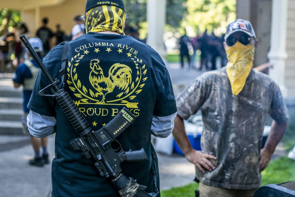 Armed members of the far-right Proud Boys groups stand guard during a memorial for Patriot Prayer member Aaron Jay Danielson on September 5, 2020 in Vancouver, Washington. Danielson was shot and killed on Saturday, August 29 during a pro-Trump rally in Portland, Oregon.