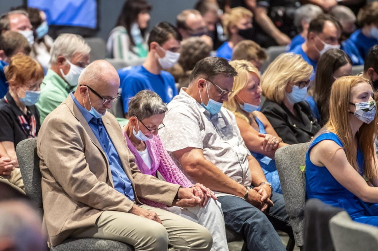 FILE--In this file photo from Sept. 9, 2020, people attending an event with Vice President Mike Pence, pray before he took the stage to speak to Marjorie Dannenfelser, president of the Susan B. Anthony List, an anti-abortion group, at Cornerstone Ministries church, in Export, Pa. a Pittsburgh suburb. Trump's selection of Mike Pence to be his vice president has often been cited as a turning point in getting evangelicals, who make up about 1 in 5 voters, to rally behind Trump four years ago.