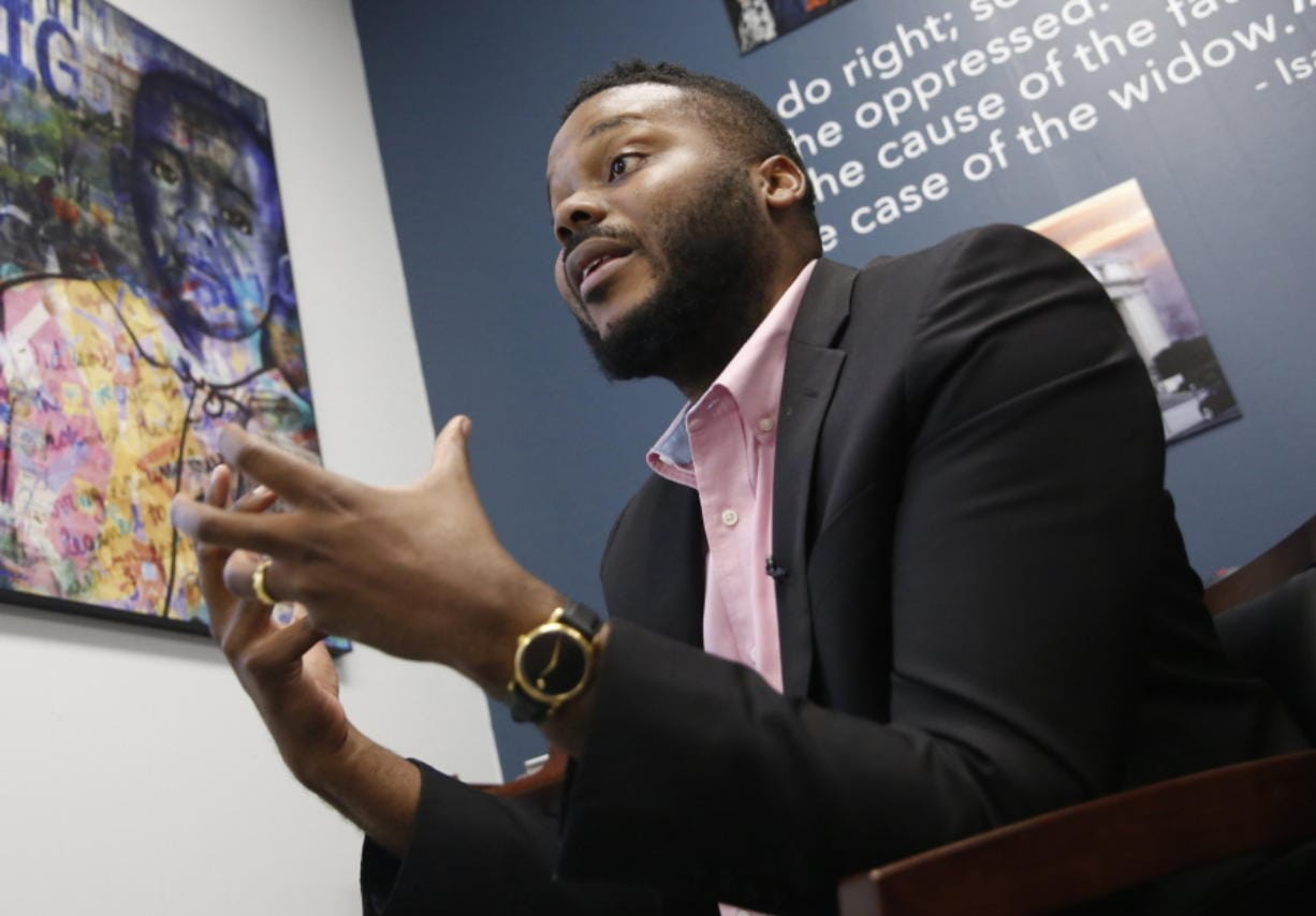 FILE -- In this Wednesday Aug. 14, 2019, file photo Stockton Mayor Michael Tubbs talks during an interview in Stockton, Calif. Mayors across the country are committing to give cash to low-income families with no restrictions on how they can spend it. It's part of a growing movement to establish a guaranteed minimum income as a way to combat poverty and systemic racism. Tubbs, launched one of the country's first guaranteed income programs last year with the help of private donations.