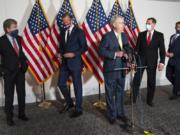 Senate Majority Leader Mitch McConnell of Ky., center, approaches the microphones accompanied by, from left, Sen. Roy Blunt, R-Mo., Sen. John Thune, R-S.D., Sen. John Barrasso, R-Wyo., and Sen. Todd Young, R-Ind., at the start of a news conference, Wednesday, Sept. 9, 2020, on Capitol Hill in Washington.