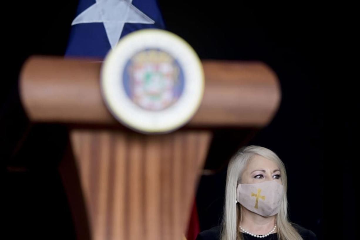 FILE - In this May 21, 2020 file photo, Gov. Wanda Vazquez, wearing a protective face mask amid the new coronavirus pandemic, attends a press conference, in San Juan, Puerto Rico. Vazquez announced Wednesday, Aug. 19, 2020, that she will place the U.S. territory on a 24-hour lockdown every Sunday as part of stricter measures to fight a spike in COVID-19 cases.