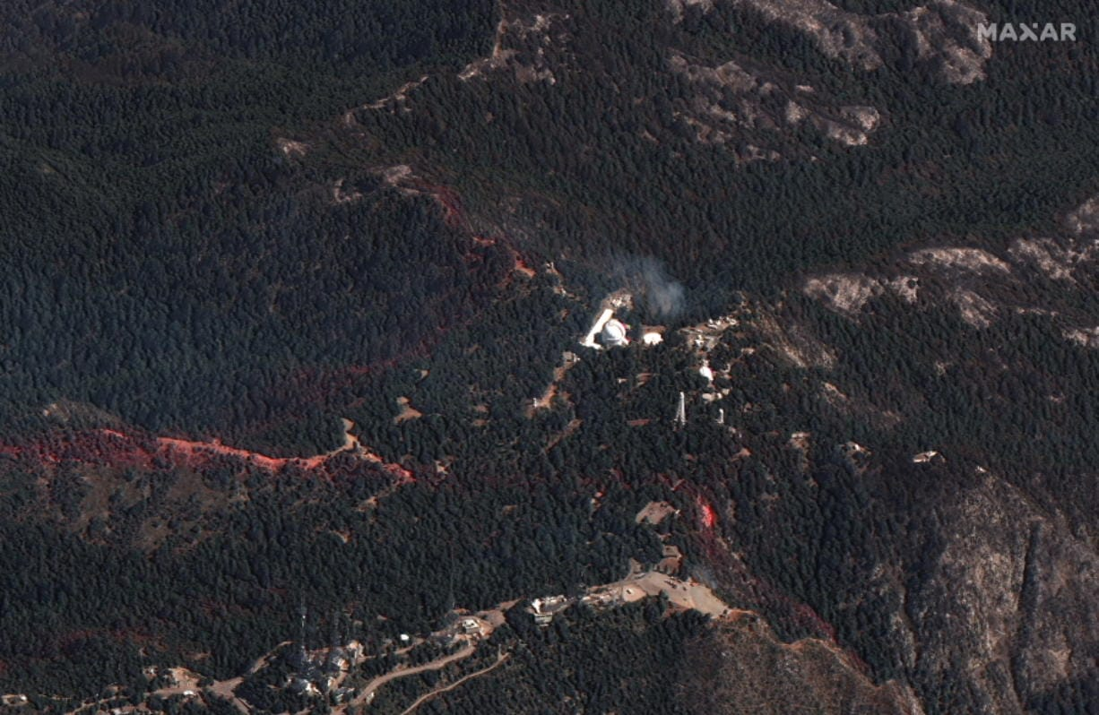 This natural color photo provided by Maxar Technologies shows a view of the Mount Wilson Observatory, center, near an area of the Bobcat Fire, Monday, Sept. 21, 2020, burning northeast of Los Angeles.