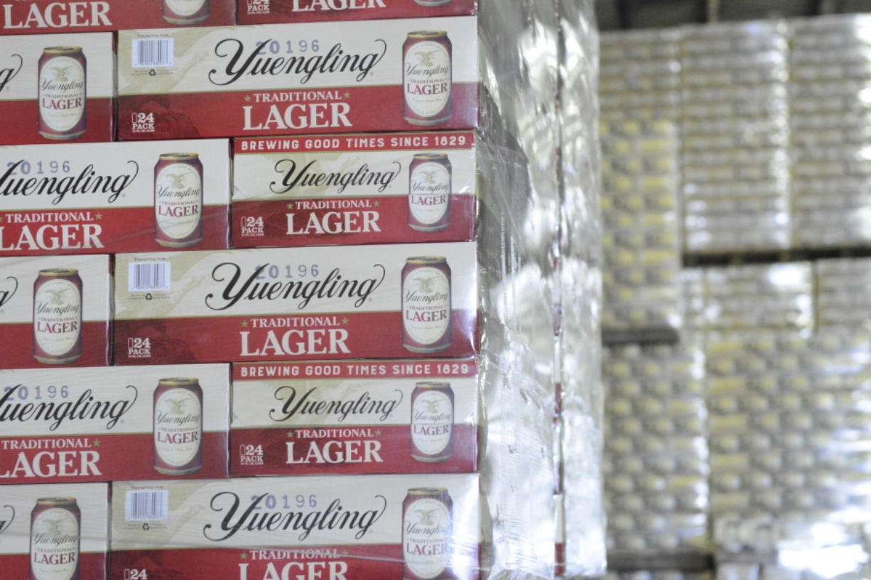 FILE - Cases of canned Yuengling Traditional Lager are stacked in the warehouse of the D.G. Yuengling & Son Brewery Mill Creek plant on Tuesday, July 21, 2020, in Pottsville, Pa. Pottsville, Pennsylvania-based D.G. Yuengling and Son Inc. said Tuesday, Sept. it's forming a joint venture with Molson Coors Beverage Co. to expand distribution of its beers beyond the East Coast.