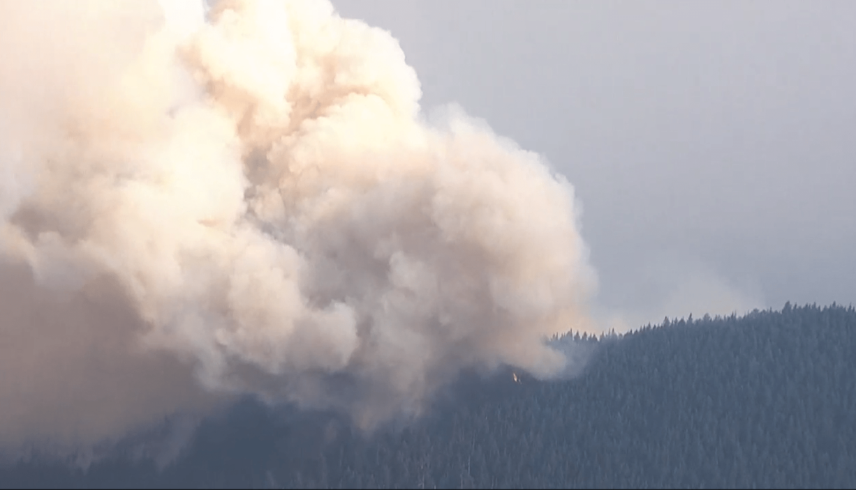 A view from a KPTV helicopter shows the Big Hollow Fire burning on a ridge in the Gifford Pinchot National Forest near Yale Reservoir.