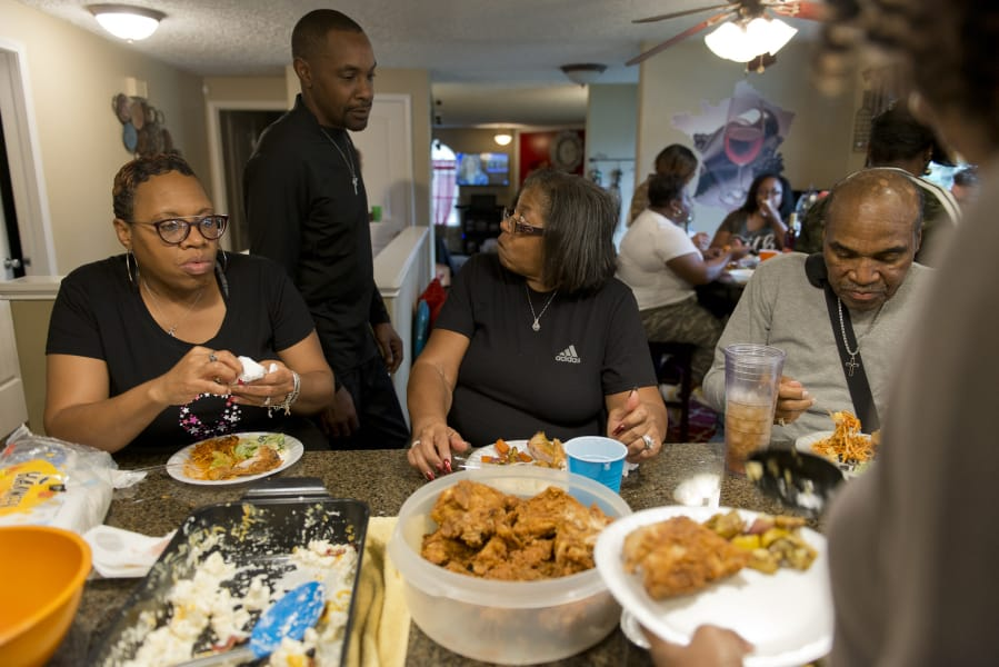 Della Frazier and Zsaneen Kennedy, mother and daughter, both survivors of breast cancer, have a twice-monthly dinner with family members at the Kennedy home last year. Kennedy told her family about her breast cancer diagnosis at a family dinner like this in 2018.