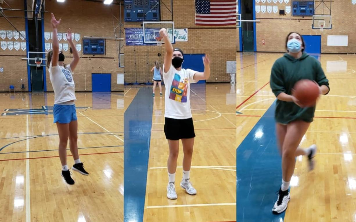 Mountain View girls basketball players Lauren DeLargy (left), Nina Peterson (center) and Ella Schoene (right) go through individual workouts this week in the Mountain View gym.
