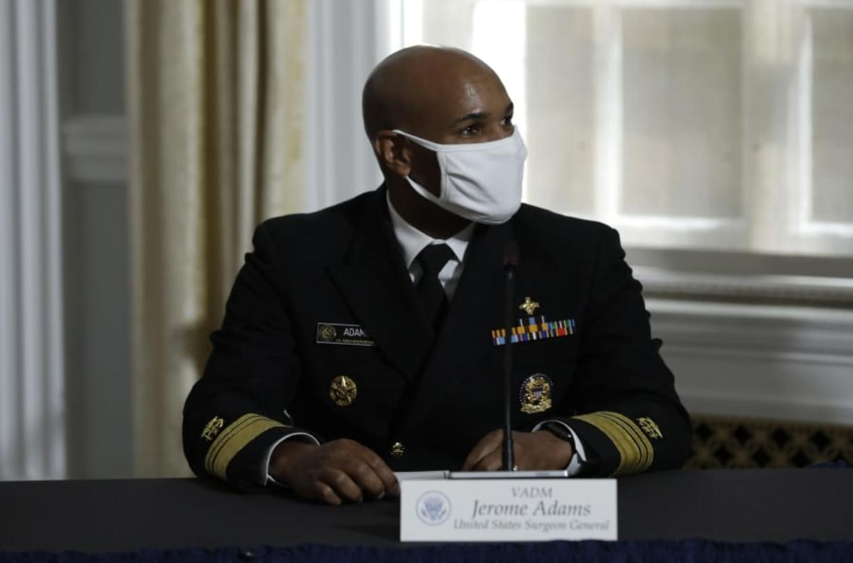 U.S. Surgeon General Vice Admiral Jerome Adams participates with President Donald Trump in a roundtable on donating plasma at the American Red Cross National Headquarters  in Washington on July 30, 2020.