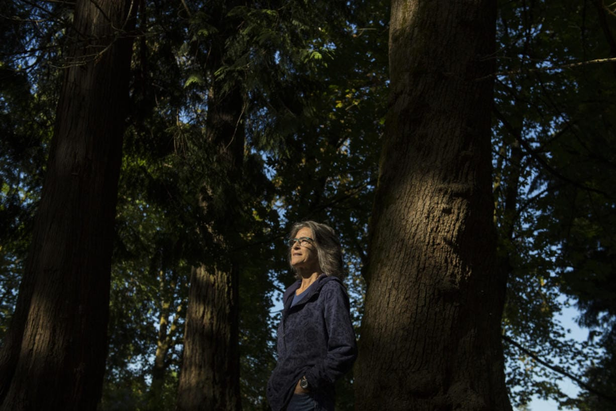 "Elizabeth Koch of Vancouver, who is a cancer survivor, explores Jorgenson Woods Neighborhood Park several times a day. Koch believes in the therapeutic power of nature and forests. ""There's awe in everything in nature. It's an everyday miracle,"" she said."