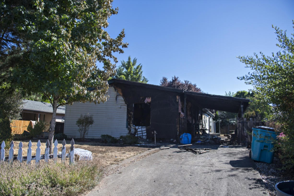 Two people were killed in a fire that consumed the residence at 6901 N.E. 149th Court in the Sifton area on Sept. 1, as seen the next morning.