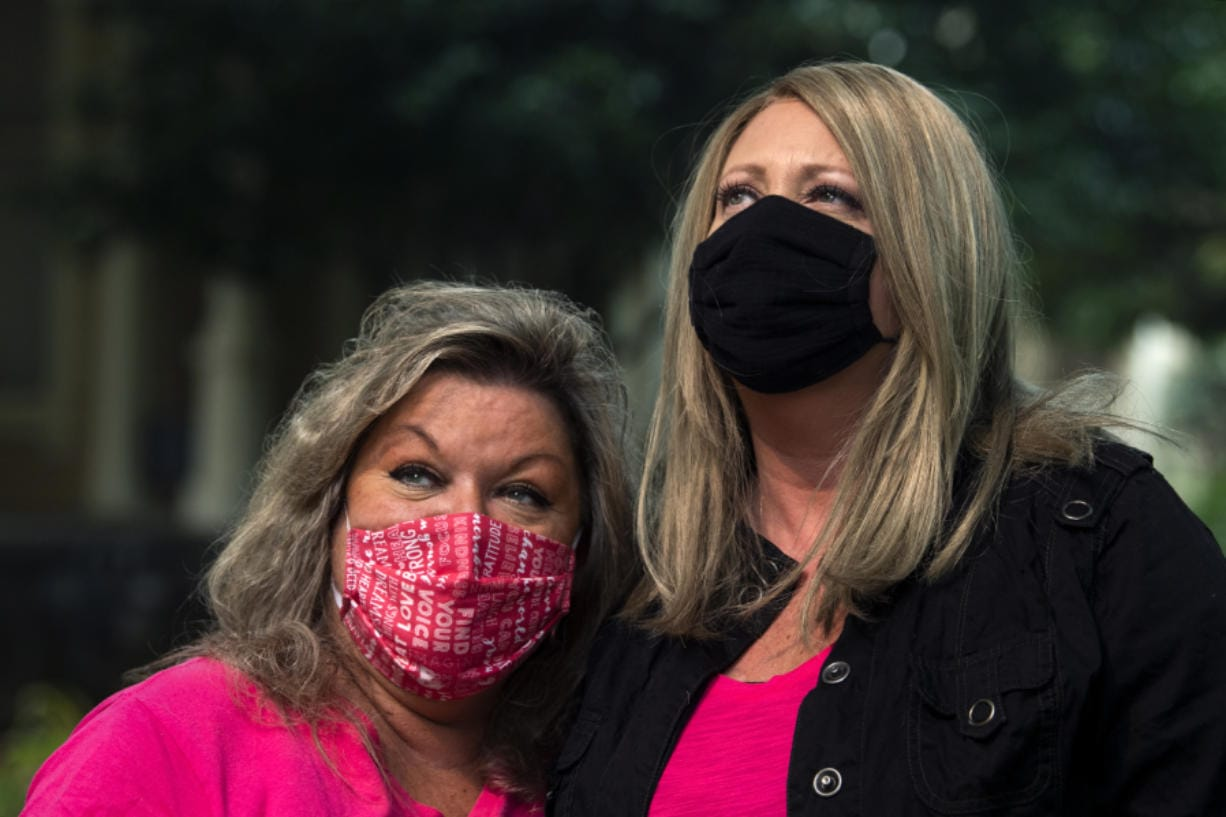 """Childhood friends Sherry Cianni, left, and Heather James found out they had breast cancer this spring and have navigated treatment together during the pandemic. """"I never though I'd have breast cancer, but I have a buddy, someone to lean on,"""" James said."""