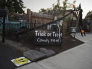 Jim and Ceci Mains' preparations for a pandemic-safe Halloween include 6-foot distance markers and a 20-foot candy slide at their home in west Vancouver.