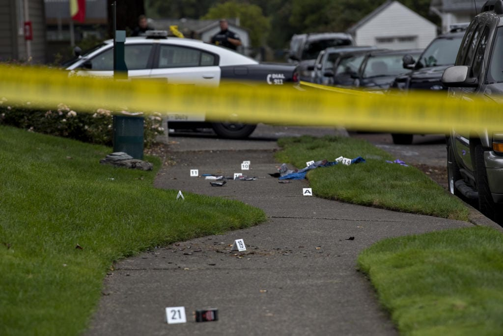 Evidence is marked as officials work at the scene after a domestic violence investigation resulted in a fatal police shooting in Vancouver's Rose Village neighborhood on Oct. 4.