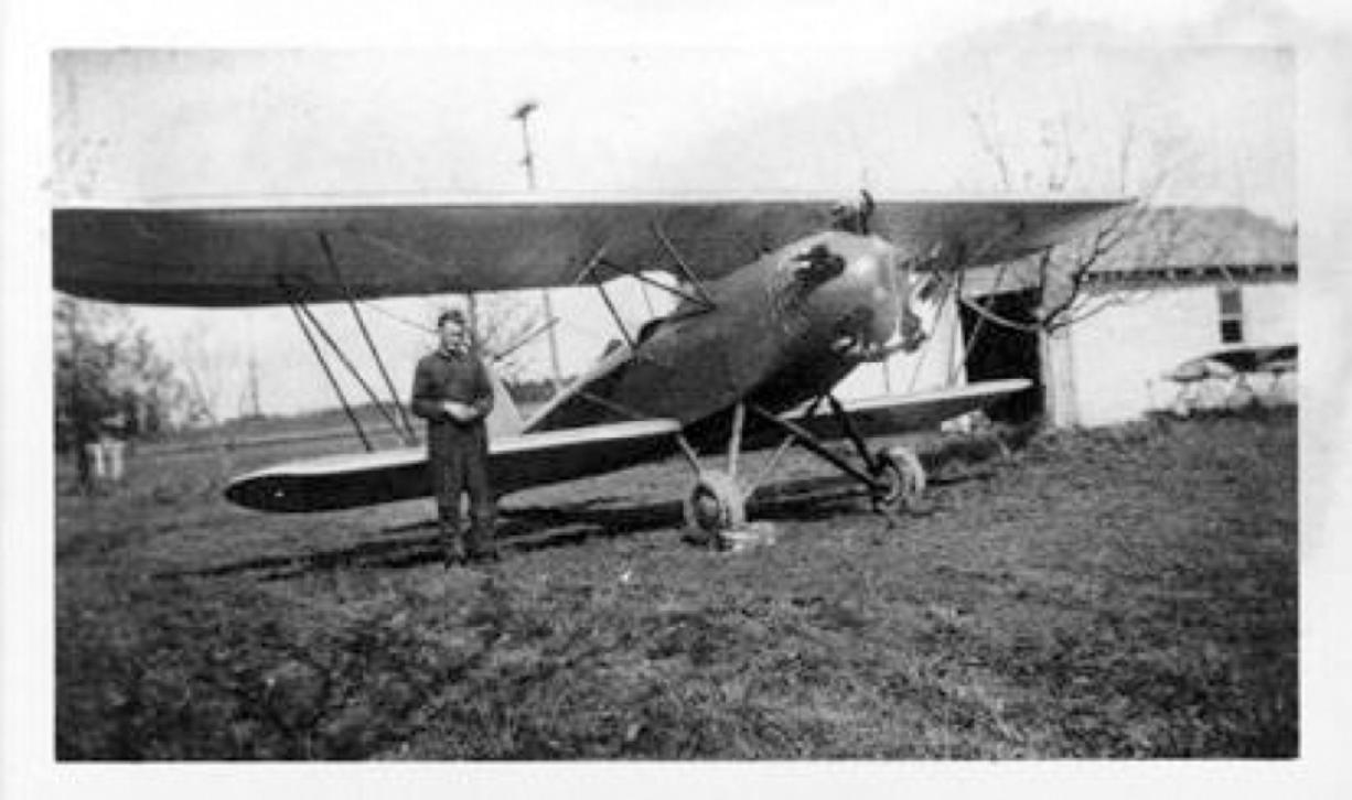 Basil Dhanens is shown with a biplane in 1931 that he probably built in his garage near today's Highway 99 and 78th Street. He was also a one-man water department and airport operator. A Belgian immigrant, pilot, weatherman and entrepreneur, he was so popular that Hazel Dell almost changed its name to Basilville.