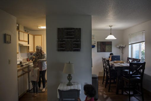 Sham Nawras, 6, prepares for a new school day with the help of her mom, Nour Alkafaween, while joined by her sister, Taj Nawras, 2, and her brother, Saif Nawras, 8, in their Vancouver apartment Monday morning.